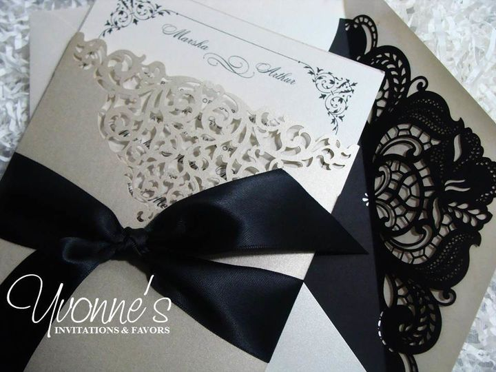 Black ribbon and lace on gold packaging