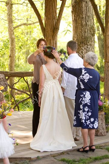 "Andrea's beautiful grandmother performed the Greek ""Stefana"" ritual."