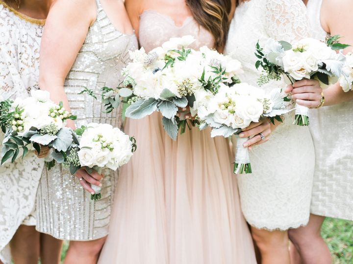 The bride with her bridesmaids holding their bouquet