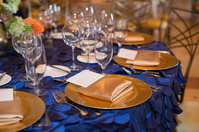 This event featured a mix of the Blue Circle Paillette Linens and the Regal Gold Damask Linens