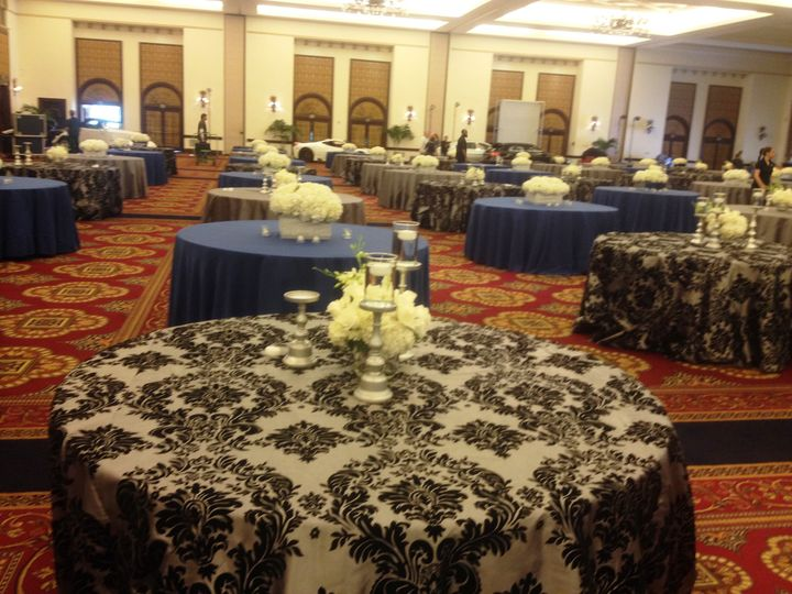 This event featured a mixture of Blue Shantung Linens, Platinum Dupioni Linens, and Silver & Black...