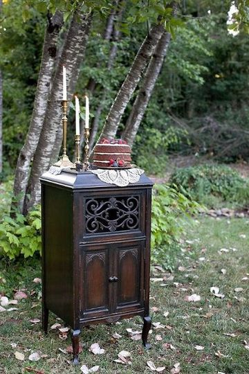 Inventory items ~ Victrola cabinet, doilies and brass candlesticks...