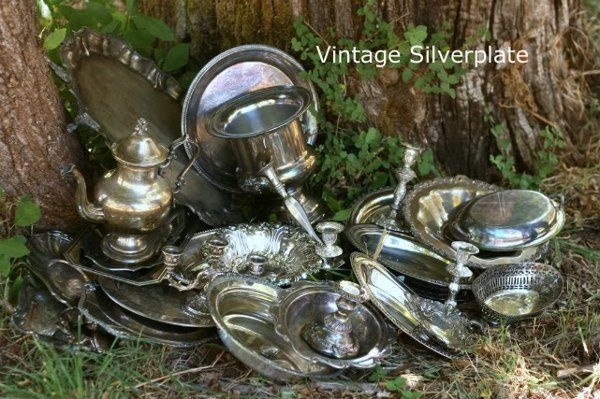 lots and lots of vintage silverplate trays, candlesticks, vases, pitchers, etc...
