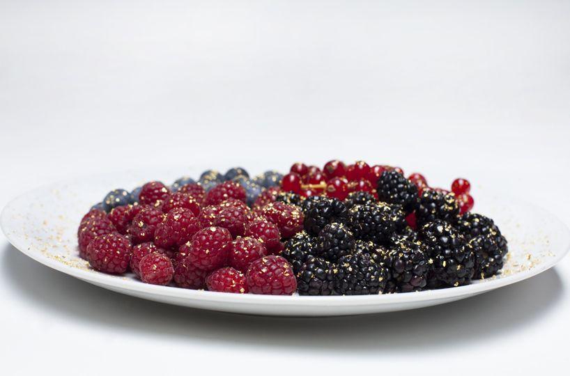 rasberries and blackberries with 24k edible gol