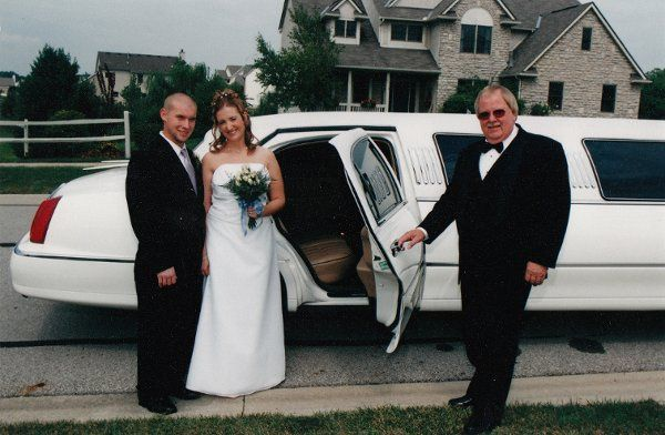 Newlyweds entering the limo