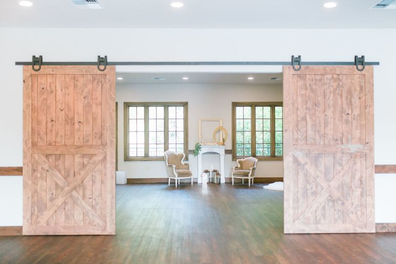 Sliding barn doors adds to the Garden Room's farmhouse luxury charm.