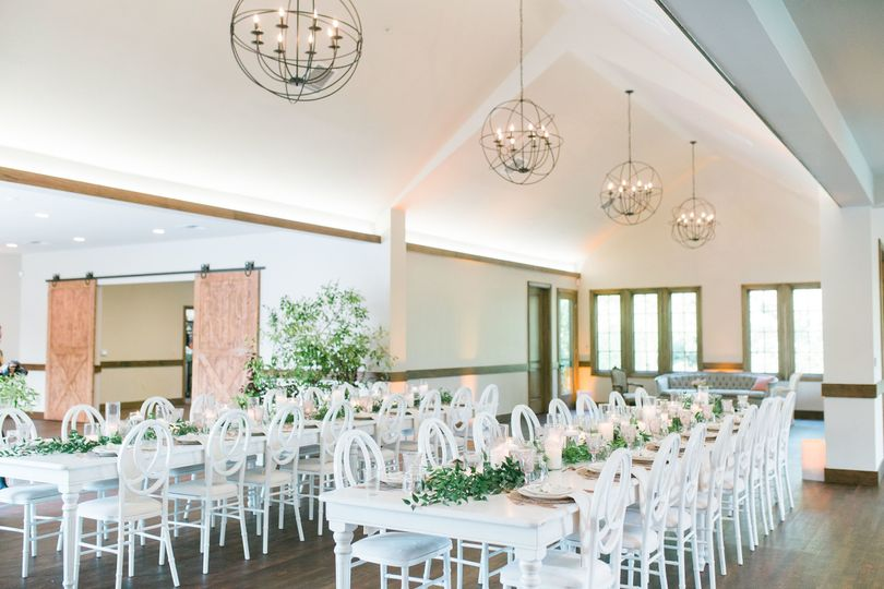 Industrial chandeliers paired with farm tables is the perfect match for a rustic wedding