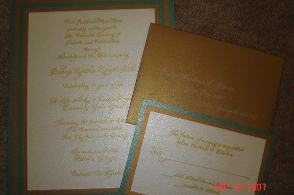 Handwritten invitations in gold ink on brushed metallic paper with matching envelopes.