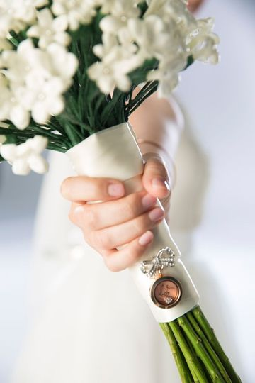 """Add a """"bow-quet"""" Locket to your bridal bouquet for a precious keepsake! Find this look today at..."""