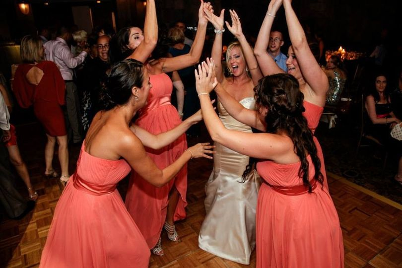 Bride dancing with the bridesmaids