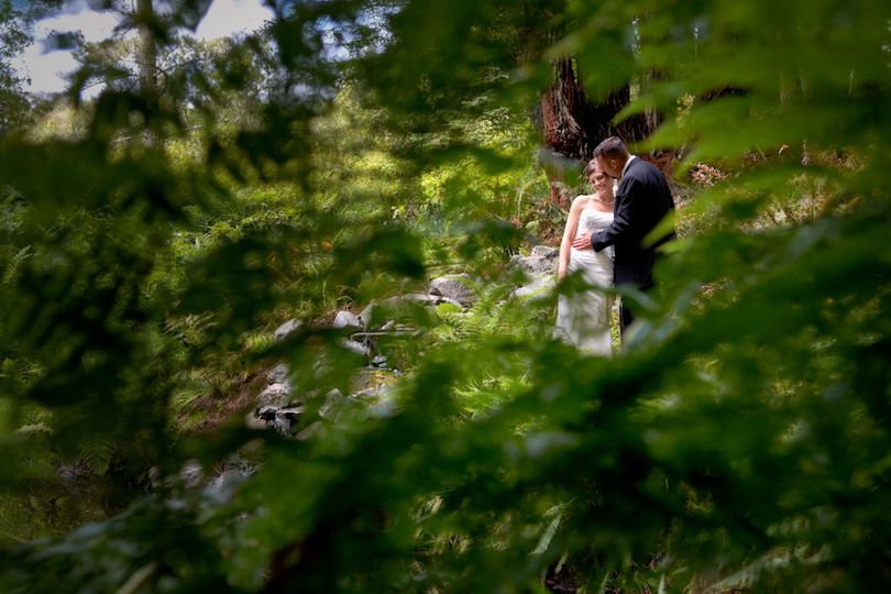 This lush forested venue was actually on the bride's family property outside of Fort Bragg,...