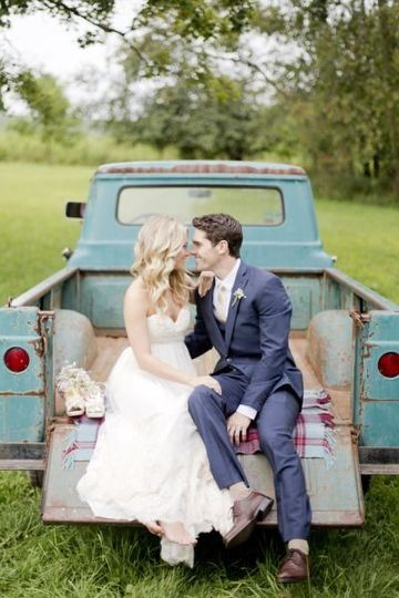 bride and groom in back of truck