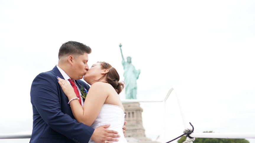 Wedding kiss aboard the Jacana by Empire Cruises
