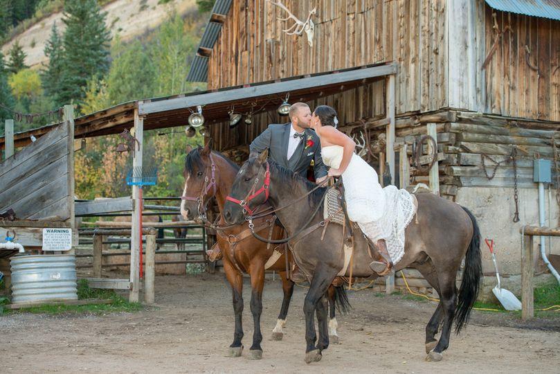 bearcat stables wedding kissing on horses