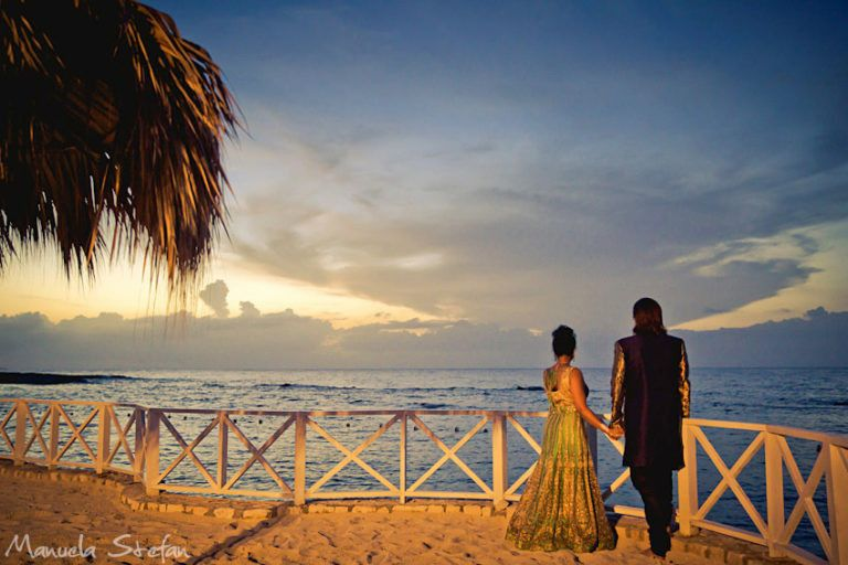 Newlyweds overlooking the sea