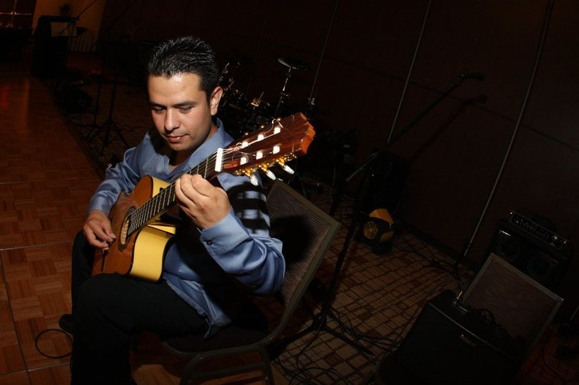 Omar playing the guitar