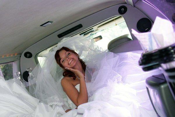 Happy bride in SUV limo