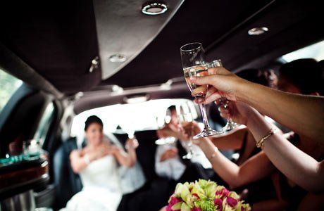 Bridal party celebrates in limo