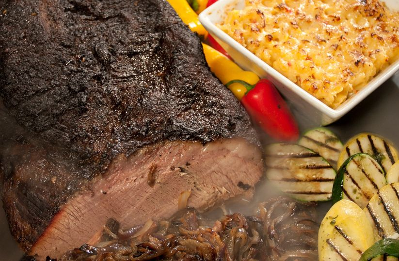 Our famous BBQ Angus Beef Brisket accompanied with our Fire Roasted Mac & Cheese and Grilled...