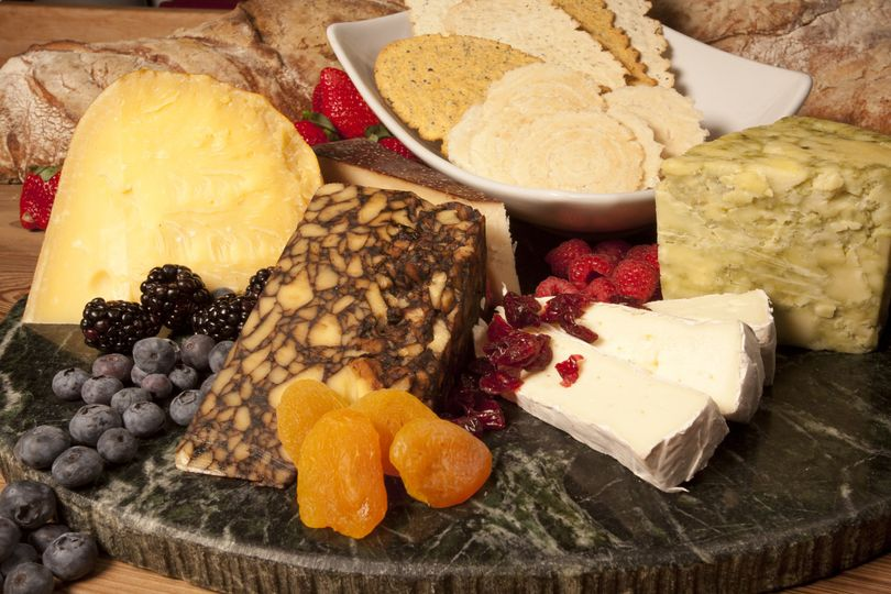 Our International Cheese Platter served with fresh seasonal fruit and crackers.