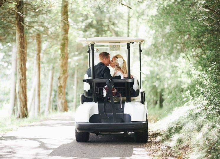 The couple riding a gold cart