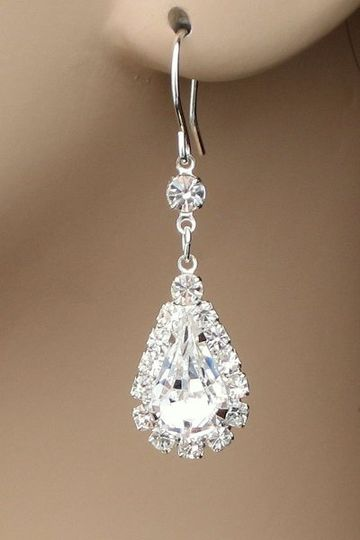 """Go for the glamour look with these pear shaped crystal earrings.  These measure 1-1/4"""" long and have..."""