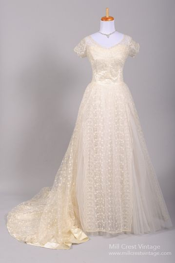 1950's Floral Lace Vintage Wedding Gown   Designed in the 50's this special vintage wedding gown is...