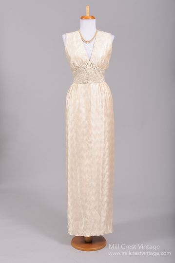 1970's Crinkle Silk Vintage Wedding Gown   Designed in the 70's, this lovely vintage wedding gown is...