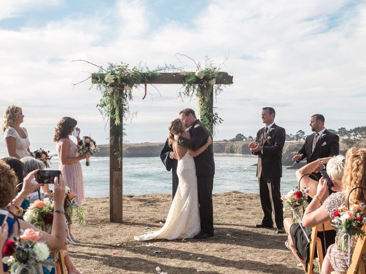 Wedding arch with fresh floral features