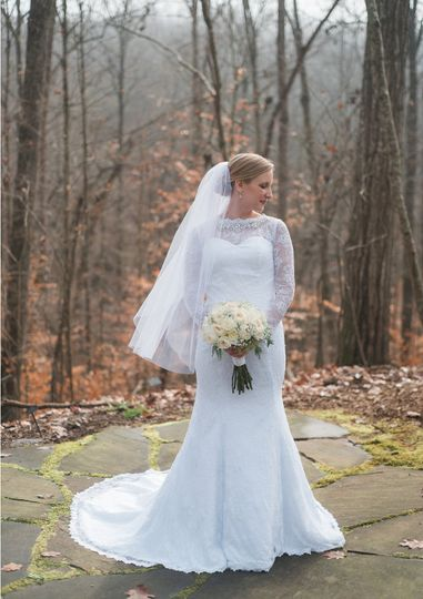 Bride in a sleeved lace wedding dress