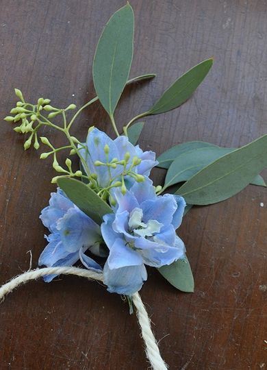 Blue and green boutonniere