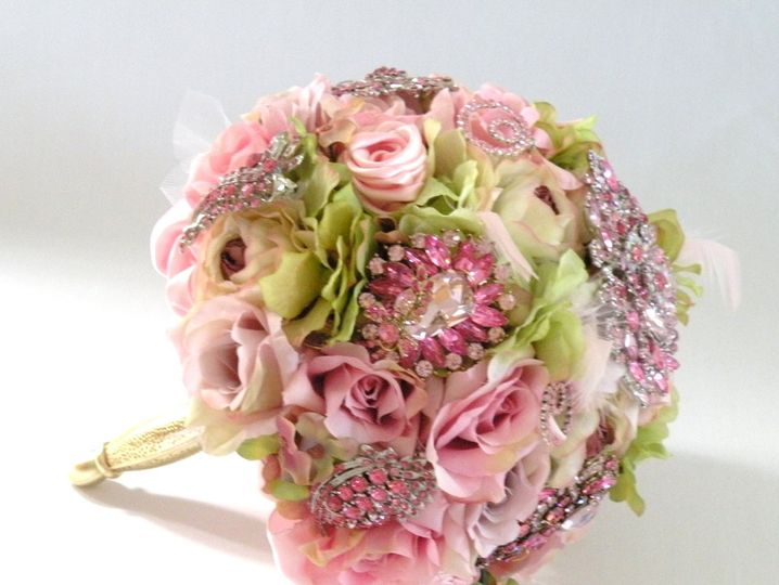 Glamourous brooch jeweled bouquet studded with rhinestone and crystal brooches, gathered in a gold...