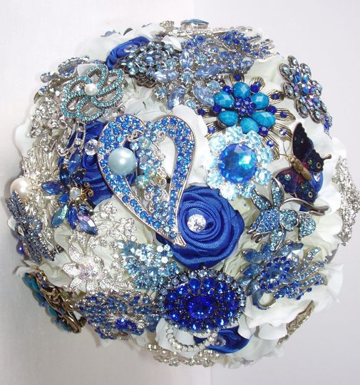 Glamourous brooch jeweled bouquet studded with rhinestone and crystal brooches, with white silk...