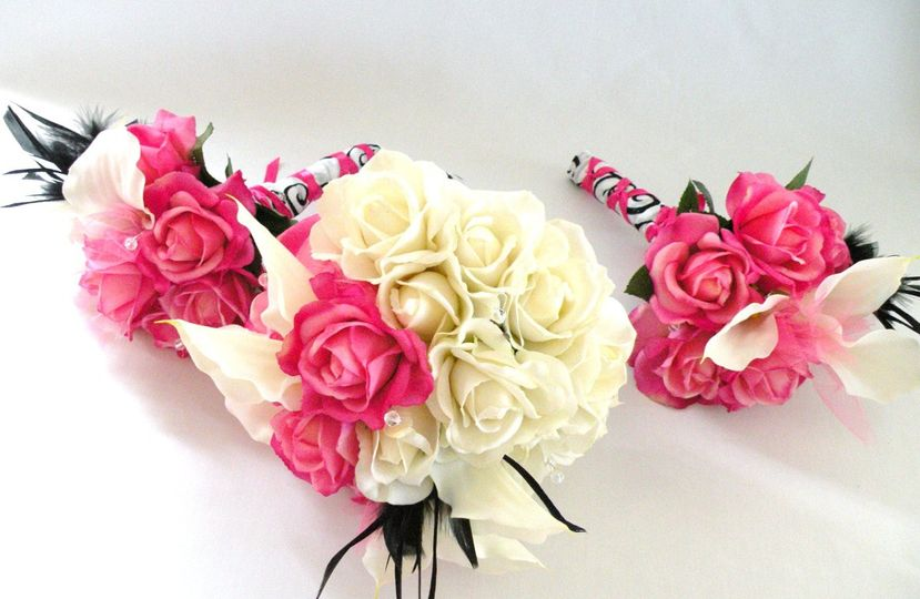 Lovely and romantic bouquet created with TRUE TOUCH silk roses and calla lilies, in ivory and hot...