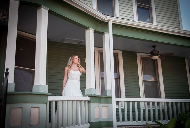 Bride by the porch