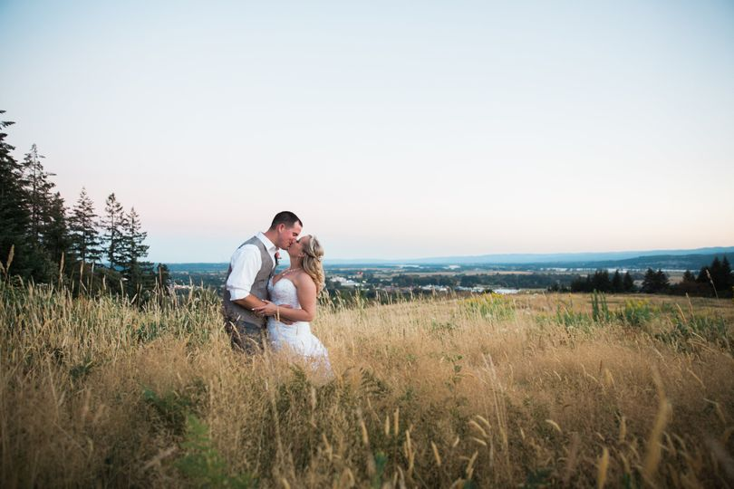 Newlyweds on hillside