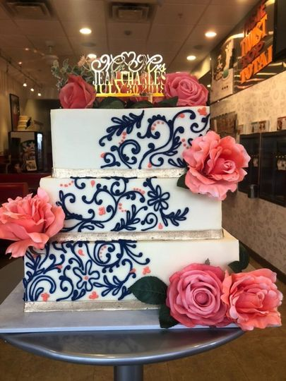 Square wedding cake with flowers