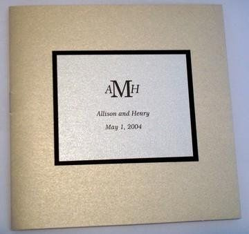 "A 5"" x 5"" booklet style program in a traditional color scheme of black, ivory and gold in a modern..."