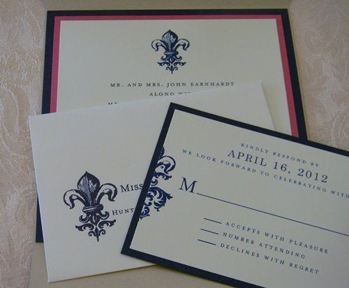 A modern fleur de lis suite for a fashionable bride in navy and fuchsia.