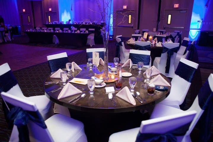 grand ballroom linenless with blue sashes