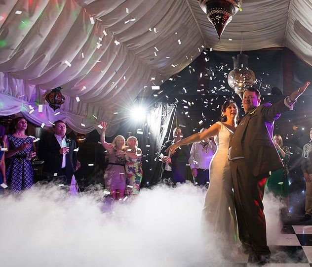 wedding first dance white confetti and dry ice cra