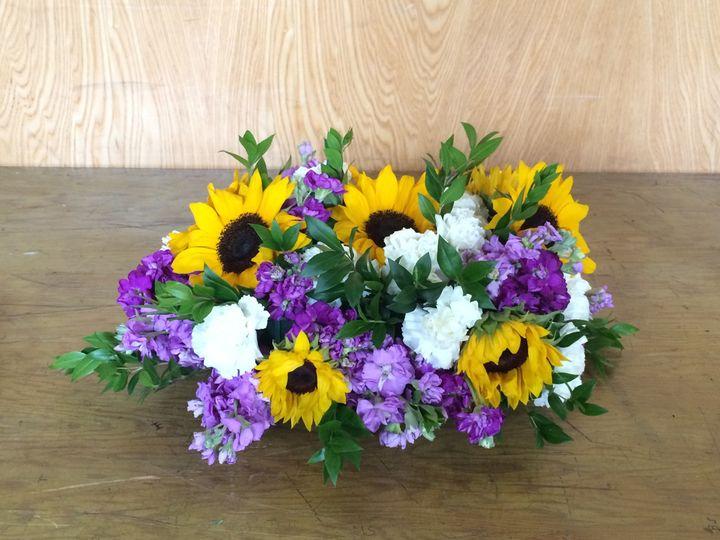 Violet and yellow flower arrangement