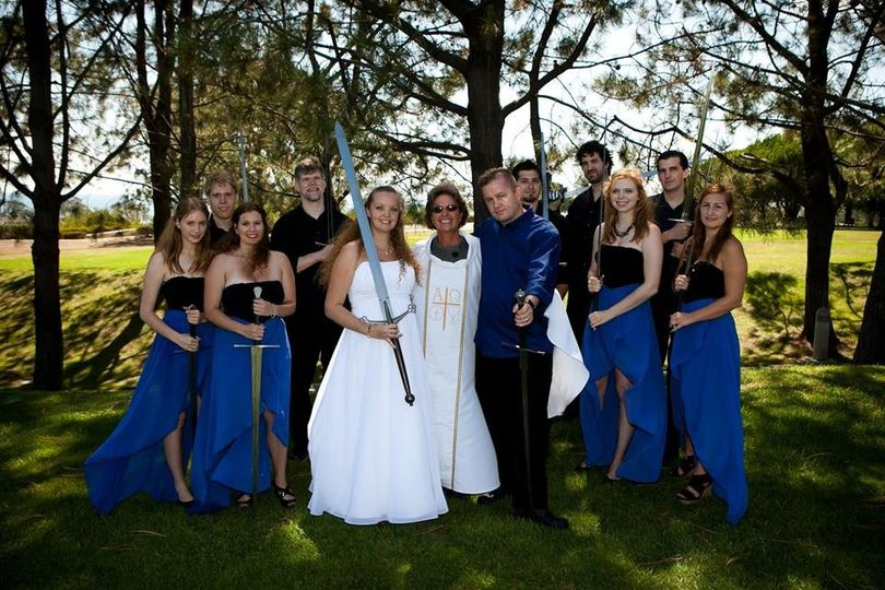 I like how the bride has the biggest sword, haha
