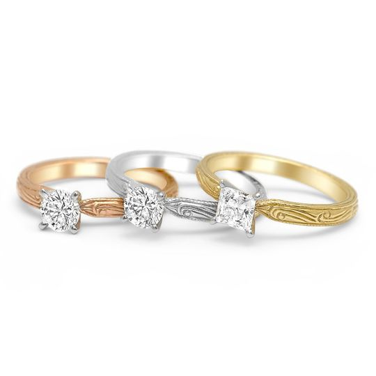 Our beautiful vintage inspired solitaires are engraved and come in a variety of colors and shapes....