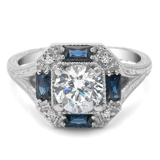 This art deco inspired ring has an engraved split shank and 4 beautiful french cut baguettes.