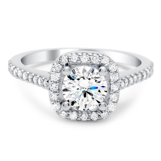 The best of both worlds: Cushion shaped diamond halo with a round diamond center.