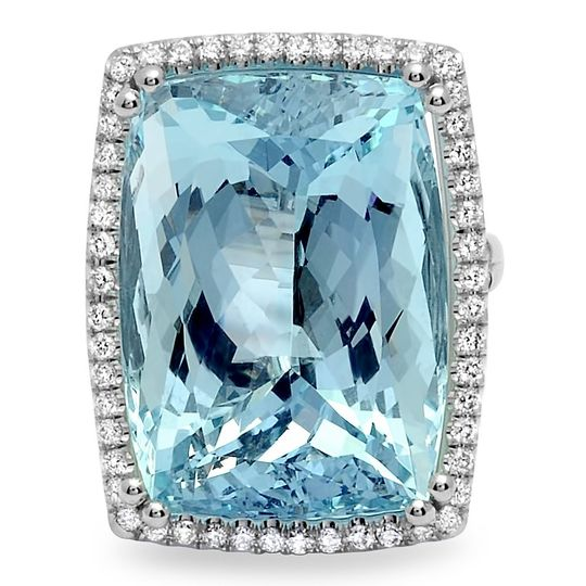 An example of one of our custom designs - 14+ carat aquamarine is set in a bed of pave diamonds.