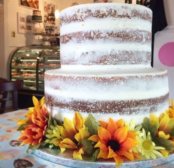 Naked cake decorated with flowers at the base