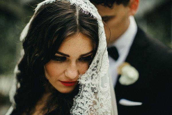 bride wearing spanish veil mantilla alencon lace