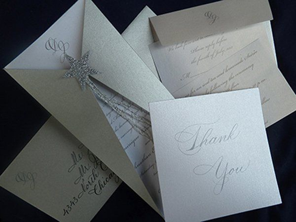 Silver invitation suite.  Handmade by Cartwheels, Louisville.  Calligraphy by Jan Hurst.